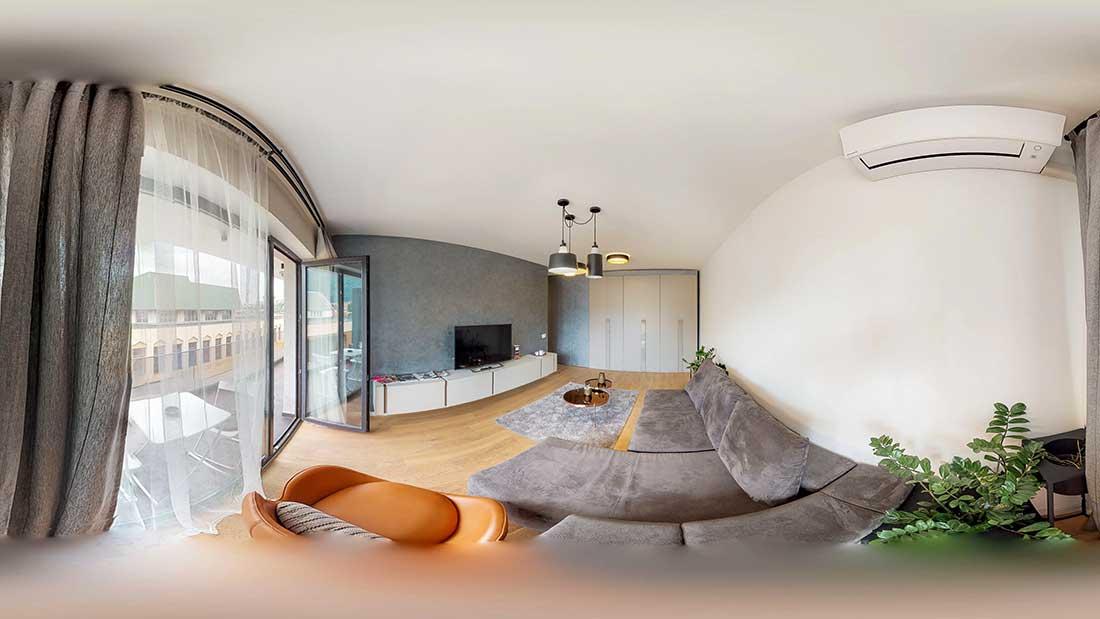 Sufrageria cu tematică gri a unui apartament în formatul unei imagini 360