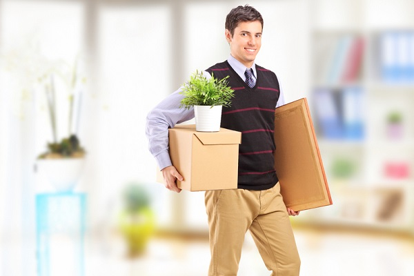 http://www.dreamstime.com/royalty-free-stock-photos-smiling-young-man-boxes-moving-apartment-image29907768
