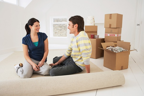 http://www.dreamstime.com/royalty-free-stock-photos-happy-couple-sitting-their-new-home-young-half-rolled-carpet-image31838138