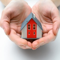 http://www.dreamstime.com/royalty-free-stock-photography-house-human-hands-presenting-small-model-image37534967