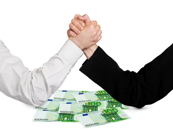 http://www.dreamstime.com/stock-images-two-wrestling-hands-money-euro-isolated-white-background-image30497574