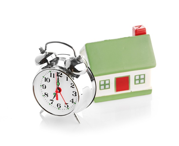 http://www.dreamstime.com/royalty-free-stock-images-toy-house-alarm-clock-isolated-white-image35493649