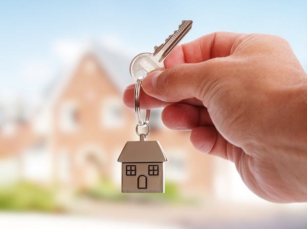http://www.dreamstime.com/royalty-free-stock-photo-giving-house-keys-holding-shaped-keychain-front-new-home-image42784335