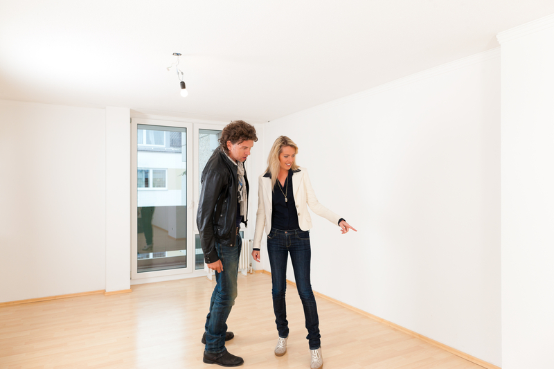 http://www.dreamstime.com/stock-photo-real-estate-market-young-couple-looking-real-estate-to-rent-buy-apartment-image30193580