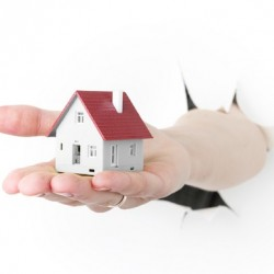 http://www.dreamstime.com/royalty-free-stock-images-house-model-toy-plastic-hand-isolated-white-image35234579