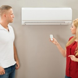http://www.dreamstime.com/stock-photo-operating-remote-control-air-conditioner-couple-image55844880