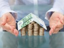 http://www.dreamstime.com/royalty-free-stock-photo-house-euro-coins-banknote-made-stack-roof-image40196795