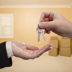 http://www.dreamstime.com/stock-photo-handing-over-house-keys-inside-empty-room-image29098630
