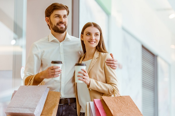 http://www.dreamstime.com/royalty-free-stock-images-couple-doing-shopping-happy-beautiful-young-holding-bags-cups-looking-showcase-smiling-standing-mall-image67281179