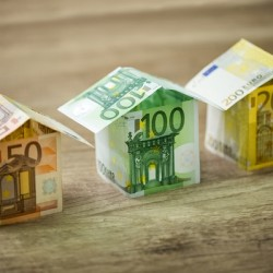 http://www.dreamstime.com/royalty-free-stock-photos-houses-made-euros-currency-banknotes-wooden-background-image66053038