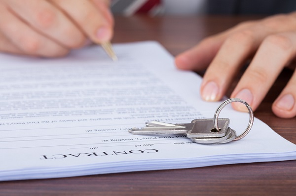 http://www.dreamstime.com/royalty-free-stock-images-man-signing-contract-keys-cropped-image-image43447009
